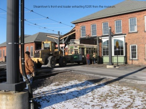 5205 being moved from the Electric City Trolley Museum Building